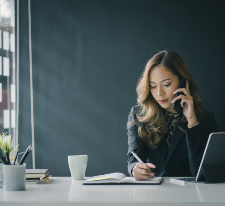 Women on Phone at Desk